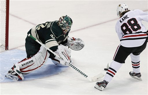 Niklas Backstrom of the Minnesota Wild battles Patrick Kane of the Chicago Blackhawks in the shootout.