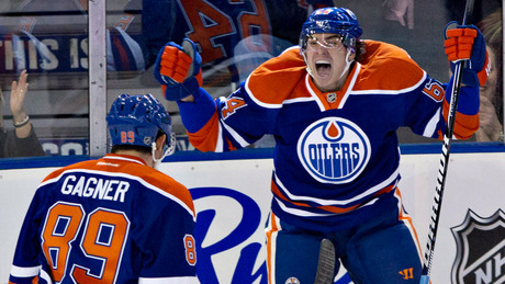 Nail Yakupov of the Edmonton Oilers celebrates in glorious fashion as he scores his first NHL goal.