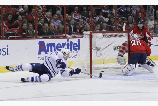 James Van Riemsdyk of the Toronto Maple Leafs scores on Michael Neuvirth of the Washington Capitals.