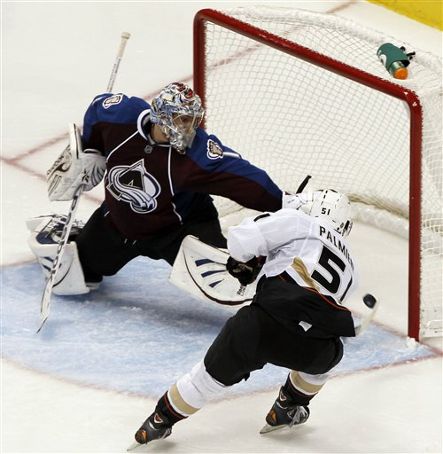 Semyon Varlamov of the Colorado Avalanche makes a stunning save against Kyle Palmieri in a losing cause.