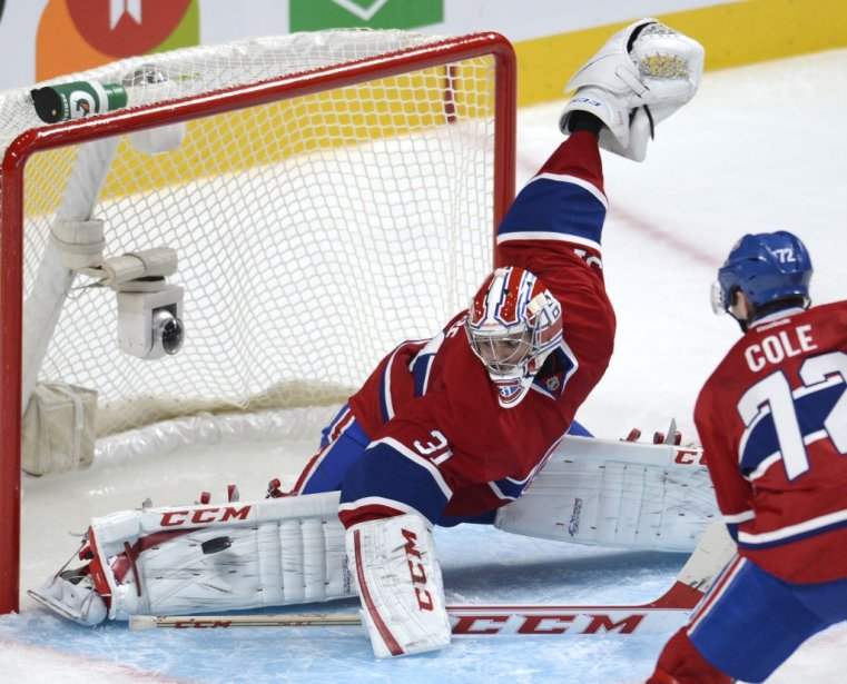 Carey Price stretches across the crease to make a save.  Image courtesy of lapresse.ca.