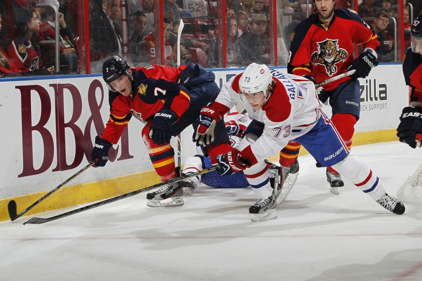 Brendan Gallagher races a member of the Florida Panthers for the puck.  Image courtesy of Zimbio.com.