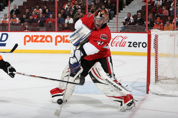 Craig Anderson plays the puck.  Image courtesy of zimbio.com.