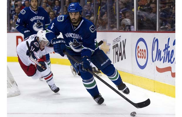 Jason Garrison skates the puck out of danger.  Image courtesy of sportsoverdose.com.