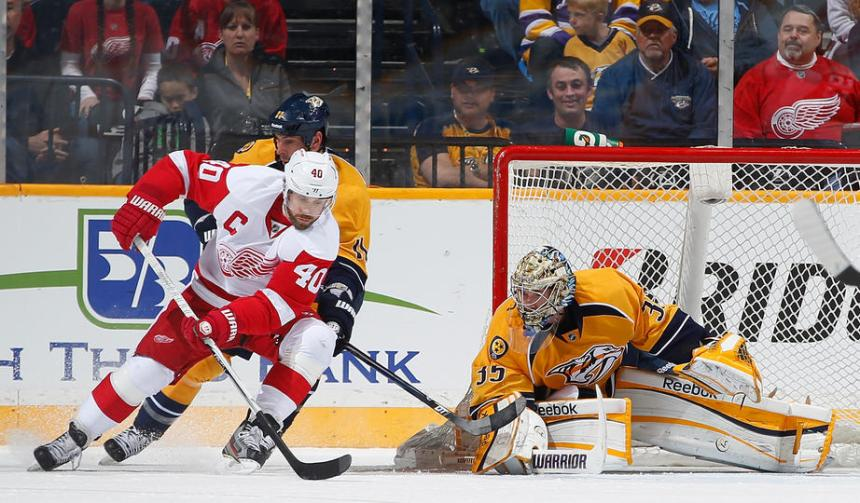 Henrik Zetterberg tries to backhand an effort past Nashville's Pekka Rinne.