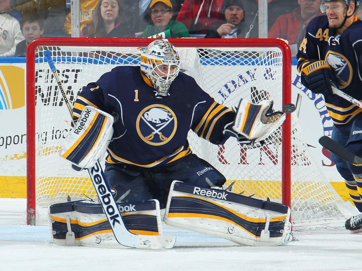 Jhonas Enroth makes a glove save against the Tampa Bay Lightning.