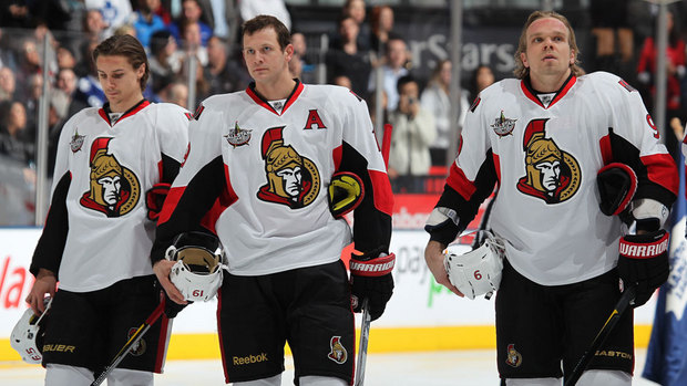 Karlsson, Spezza and Michalek during the anthems.  Image courtesy of cbc.ca.