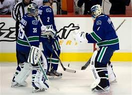 Luongo and Scheider stay professional despite goalie controversy.  Image courtesy of the Vancouver Sun.