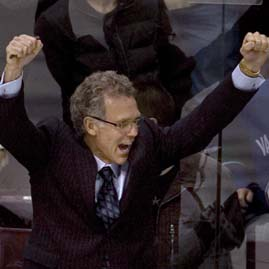 Oilers head coach MacTavish celebrates after winning the shootout against the Vancouver Canucks in Vancouver