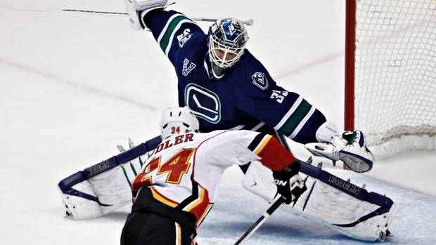 Corey Schneider leaps across the crease to make a save.  Image courtesy of the Globe & Mail.