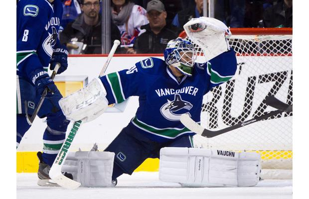 Corey Schneider makes a glove save.  Image courtesy of the Montreal Gazette.