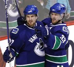 The Sedin twins celebrate yet another goal.  Image courtesy of the Vancouver Sun.