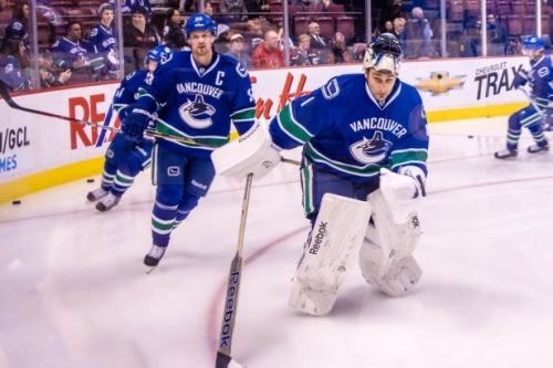 Henrik Sedin and Roberto Luongo circle the rink during warm-ups.  Image courtesy of the Vancouver Observer.