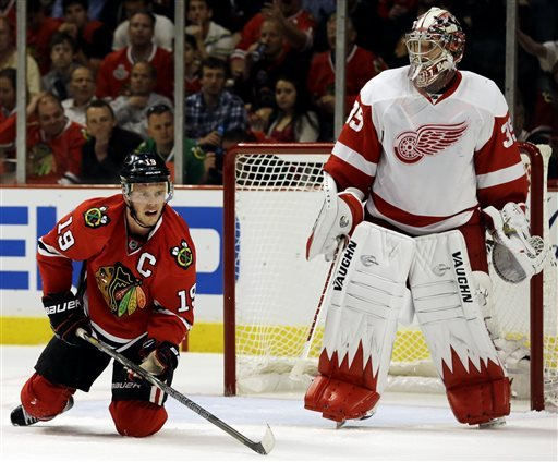 Chicago Captain Jonathan Toews and Jimmy Howard wait for the puck during Game Two of the series. (Courtesy of ca.sports.yahoo.com)