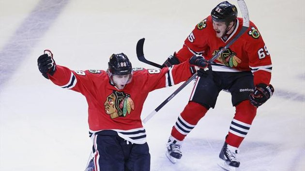 Chicago's Patrick Kane celebrates scoring the OT winner which finished the series. (Courtesy of uk.eurosport.yahoo.com)