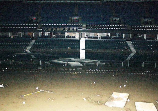 The first eight rows of the Calgary Flames' Scotiabank Saddledome are submerged in flood-water.  (Courtesy of sports.yahoo.com)
