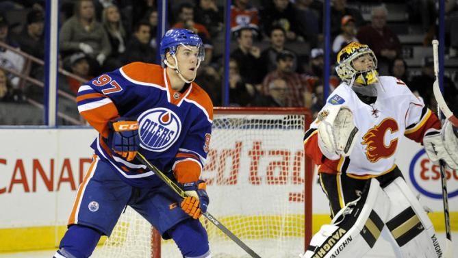 EDMONTON , AB - SEPTEMBER 21:  Connor McDavid #97 of the Edmonton Oilers looks for a pass in front of goalie Mason McDonald of the Calgary Flames at Rexall Place on September 21, 2015 in Edmonton, Alberta, Canada.(Photo by Dan Riedlhuber/Getty Images)